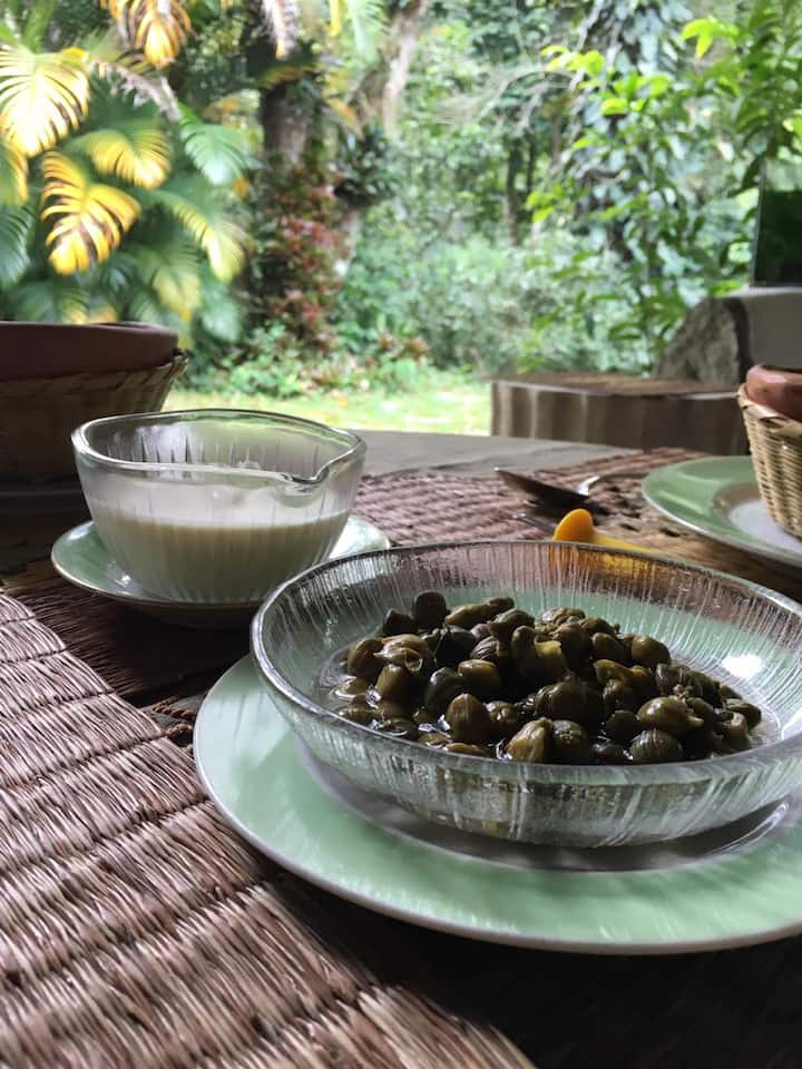 Ajiaco's garnish:  capers and cream.