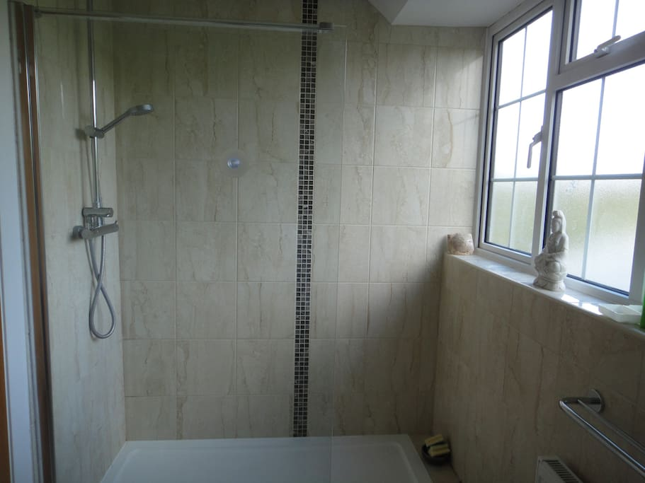 Modern shower room with toilet and was basin