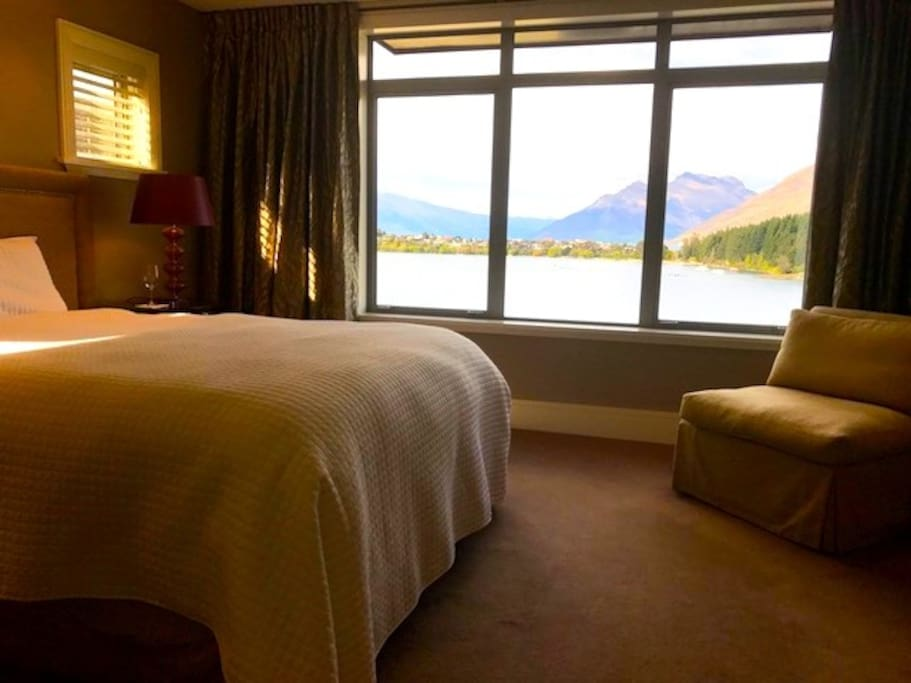 Your queen room enjoys wide lake and mountain views.