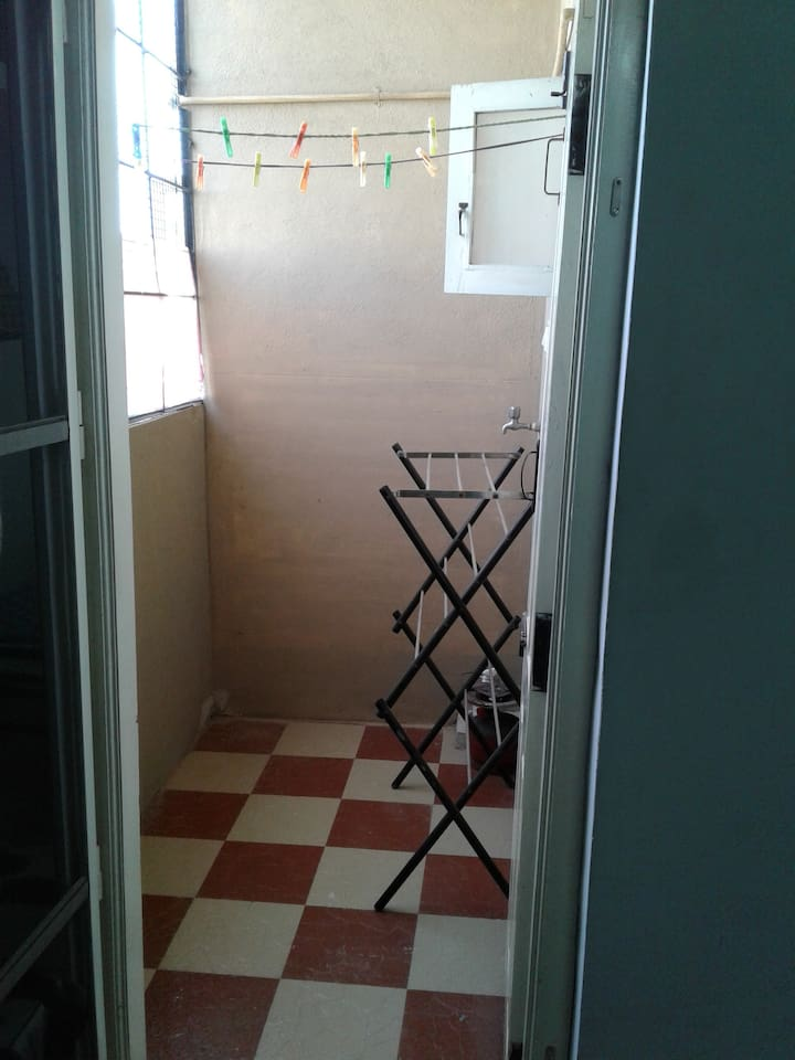 Utility area , Clothes drying stand .