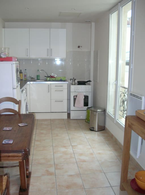 big kitchen with all you need to cook at home