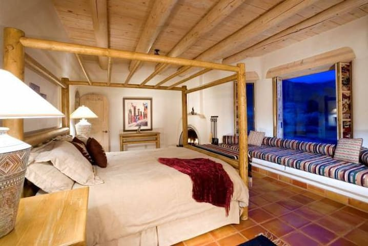 Master bedroom with large picture windows and mountain views