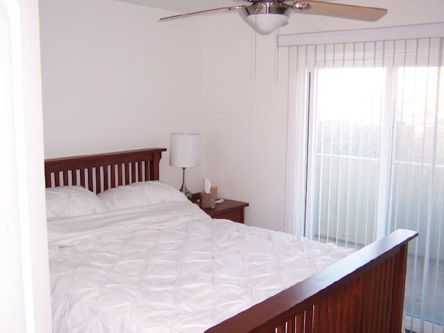 Separate bedroom with queen size bed.