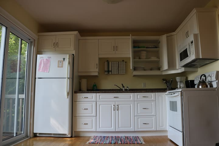Kitchen comes with all cooking essentials, cutlery, coffee maker (with coffee grounds), tea kettle, microwave, stove top, oven, double sink