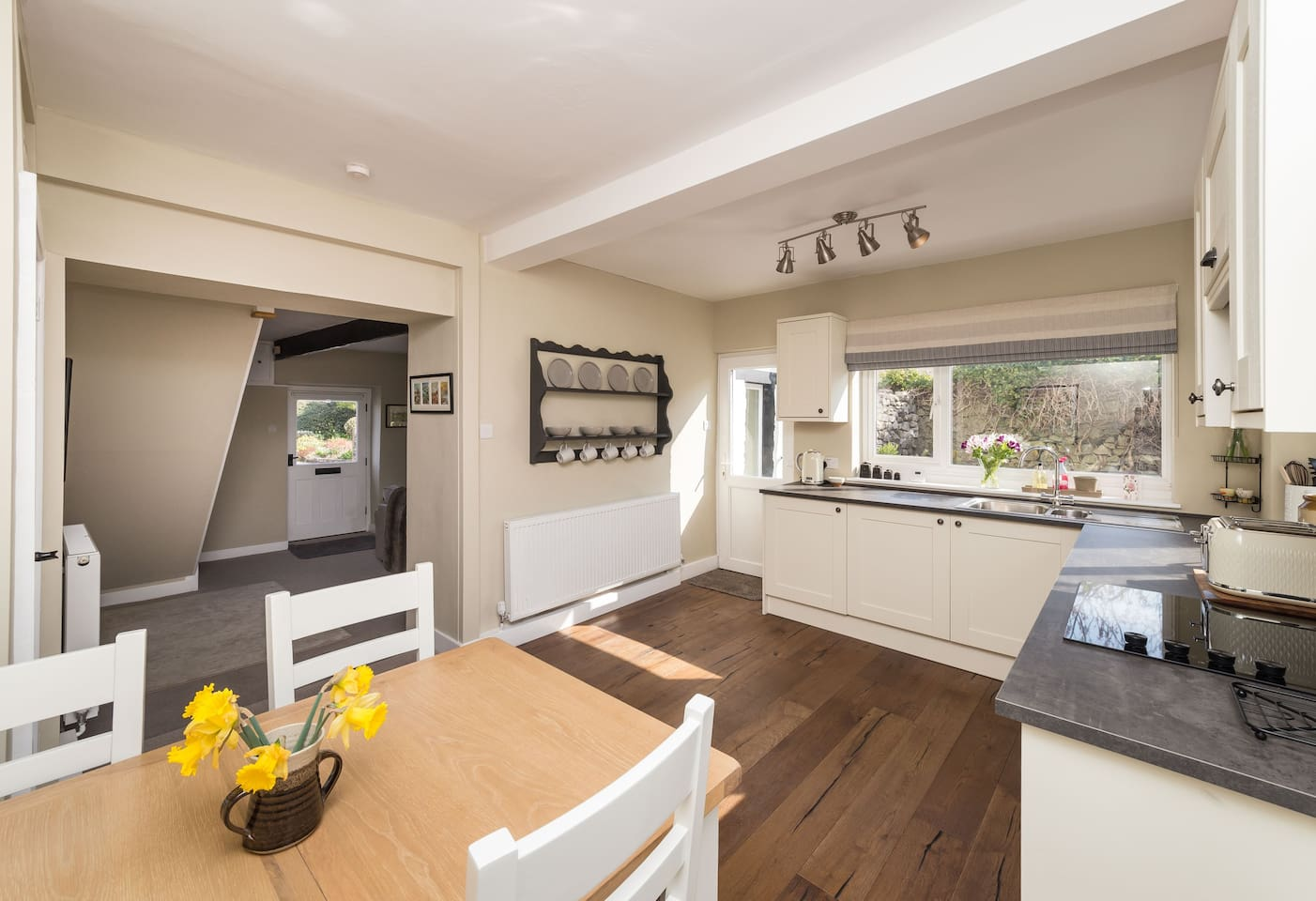 Open plan living, the spacious kitchen diner leads directly through to the living room.