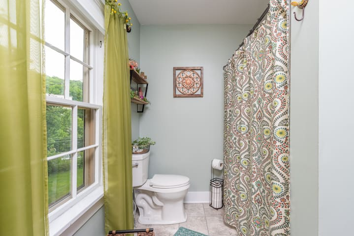 Lovely, full bathroom with shower and bathtub.