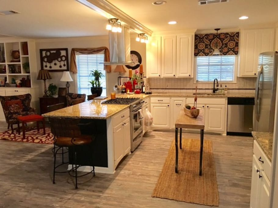 Kitchen with granite counter open to living area