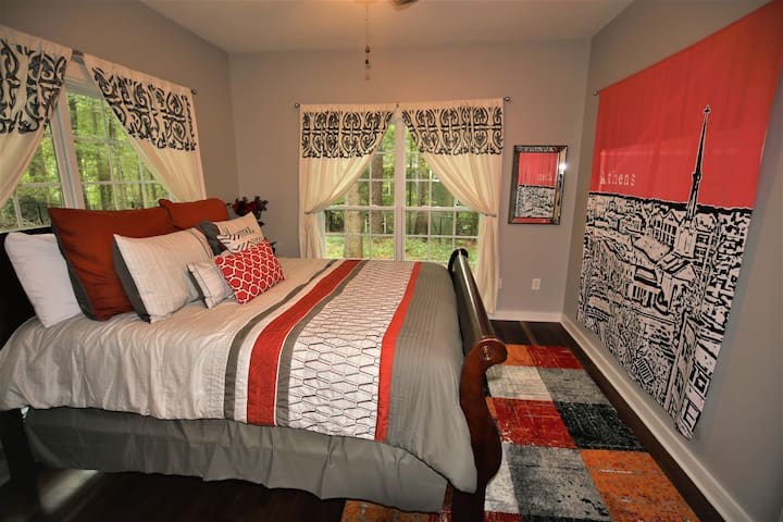 The Red Room boasts an amazing view with two large windows, a large queen sleigh bed, walk-in closet, and side table complete with built-in USB charging port