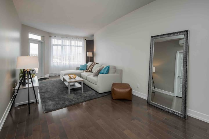 Relax in the living room after a fun day on the town. The TV has Netflix & Amazon Prime. The patio door is off the living room.   The sofa pulls out to be a double bed.