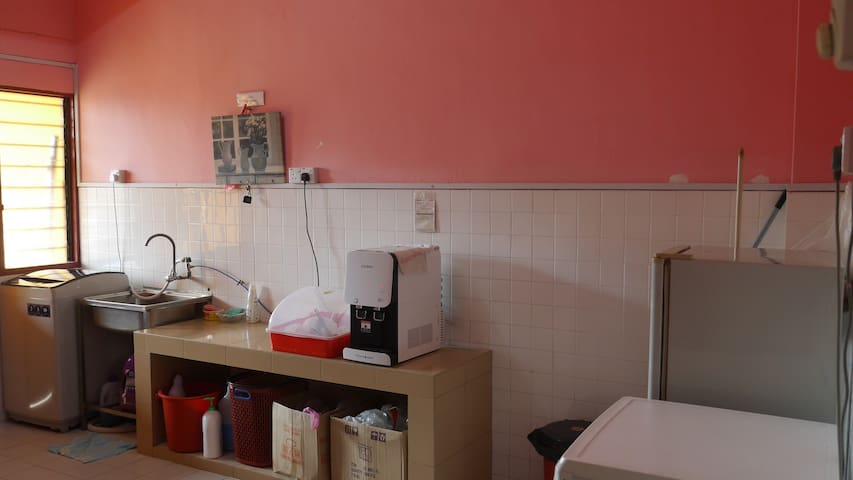 Kitchen, with Cuckoo Water Filter, fridge, washing machine and dyer.