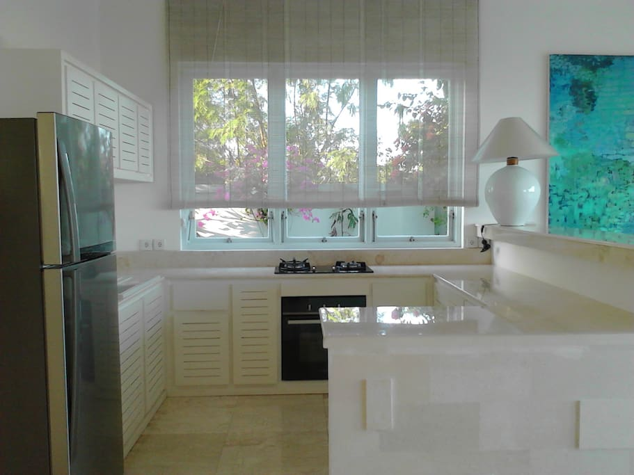 Kitchen over looking to the swimming pool and sea view
