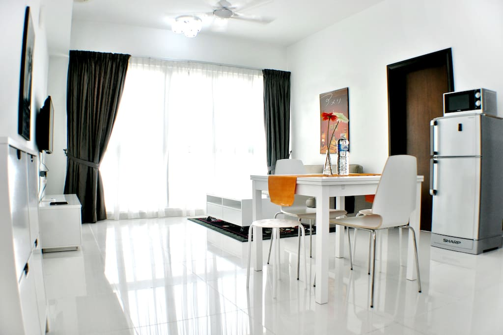 Walk into a soothingly bright apartment that lets you start the day on a positive note.
