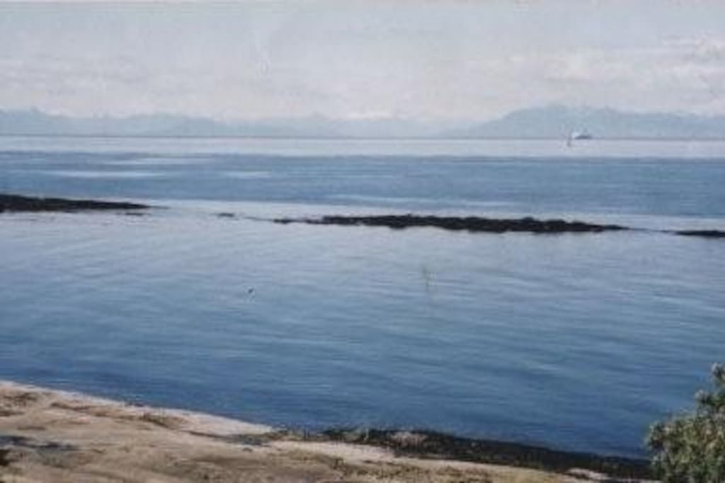 View from upper deck at low tide with North Shore Mountains.
