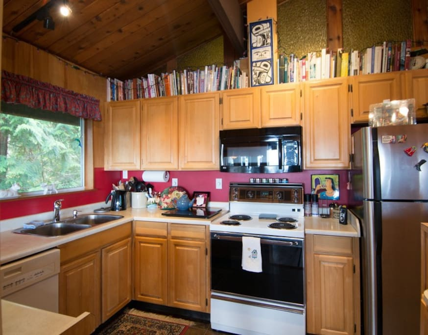 Kitchen with extensive cookbook library.