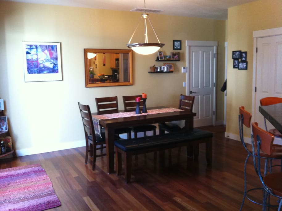 Dining room with access to yard. Table seats 8. Adjacent bar seating for 4 more.