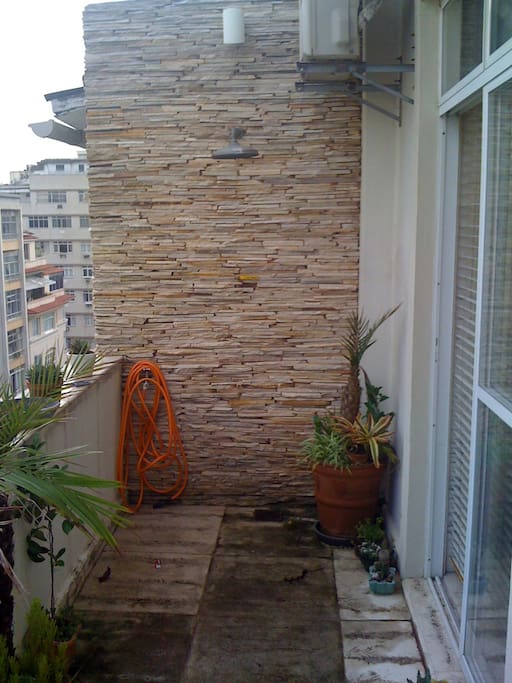 Outdoor shower on terrace for your after beach rinses.