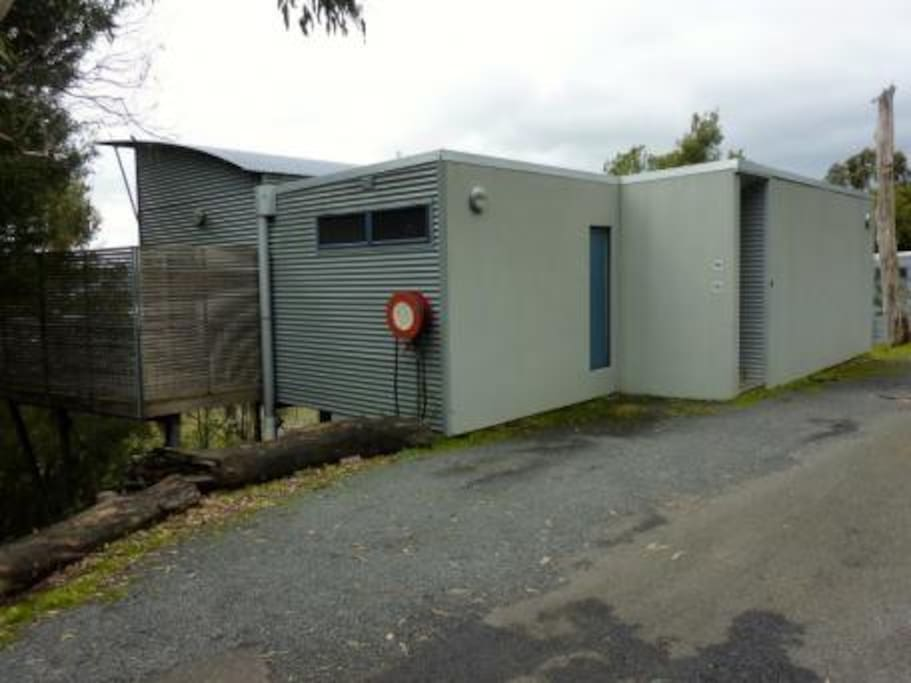 Parking and side view of 2 bedroom chalet