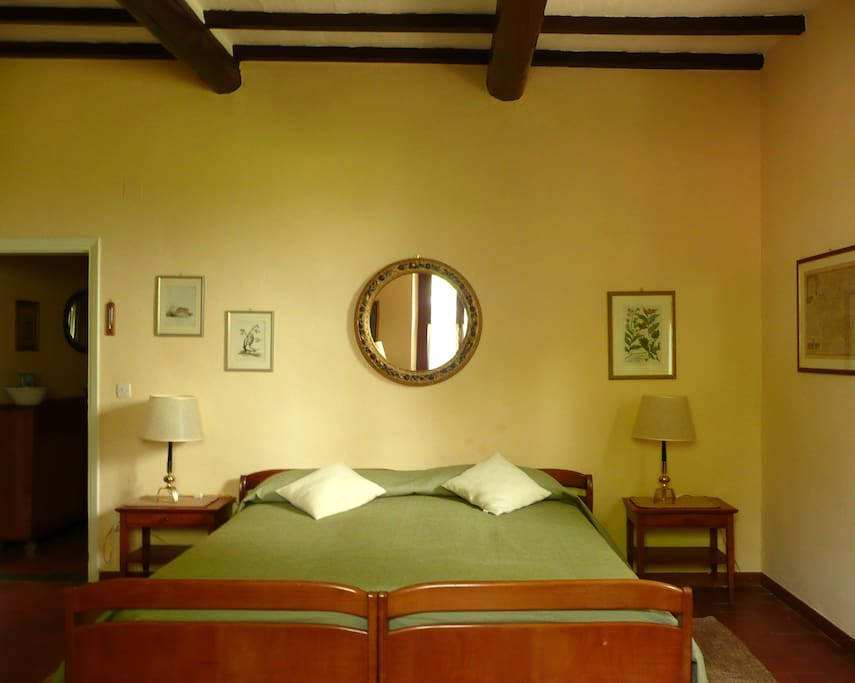 Casa Colonica - Master Bedroom: beamed ceiling, antique prints and furniture, and two large windows onto gardens!
