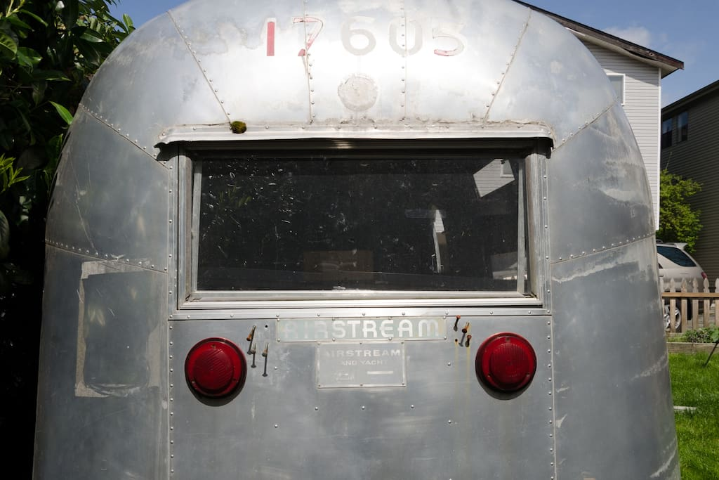 This is rear of the airstream the bed backs up to this wall.