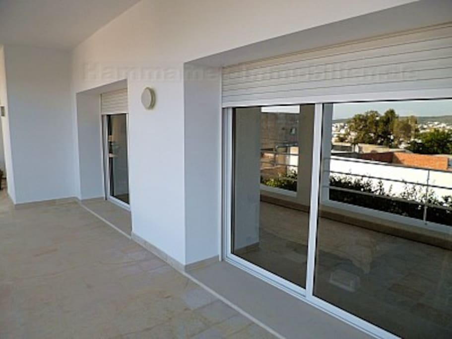 Large Balcony with Sun Protected Glass and Automated Roller Shutters