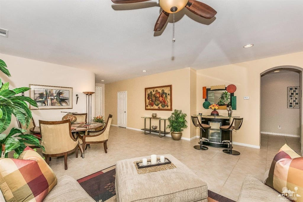 Large Open Living Room w/ bar and dining table