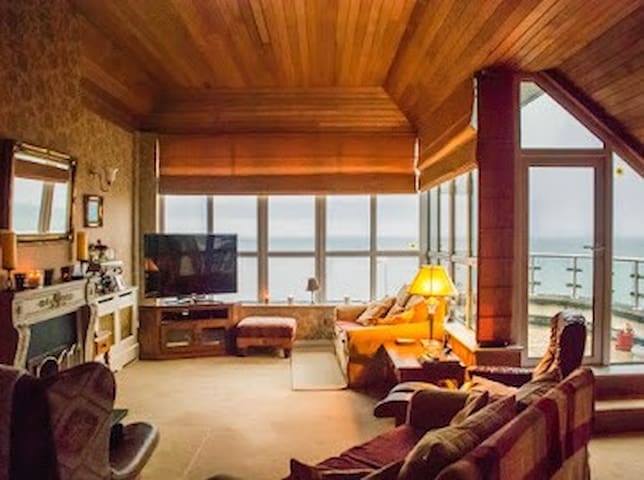 LIVING ROOM OVERLOOKING FAMOUS SALTHILL PROMENADE,GALWAY BAY,AND CLARE HILLS