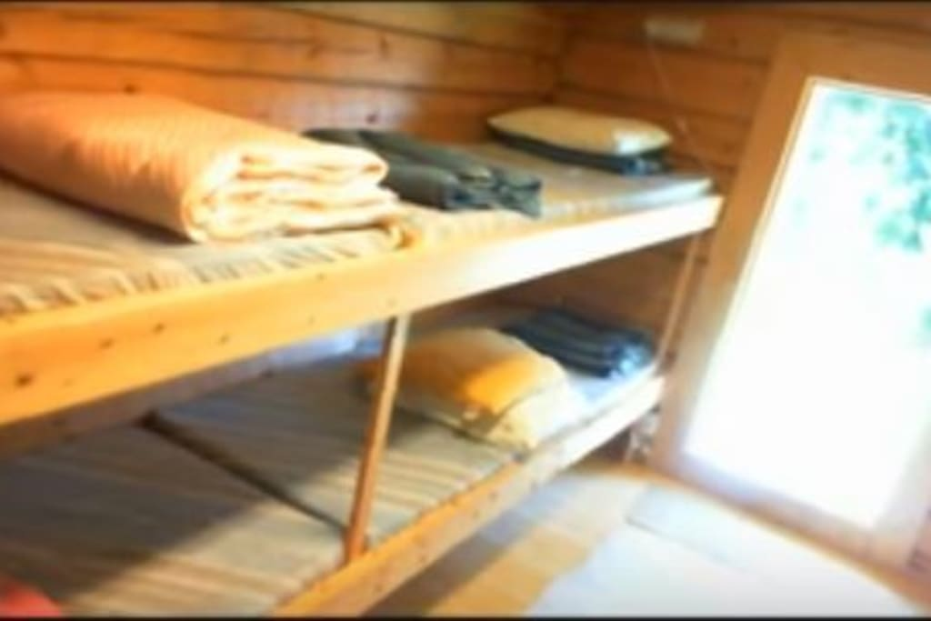 12m2 cabin with 4beds and 2pit stove and  refrigiator