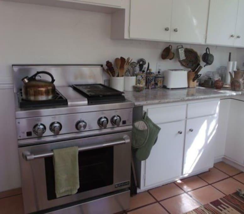 Kitchen, new ss appliances, new granite countertops, leaded glass window