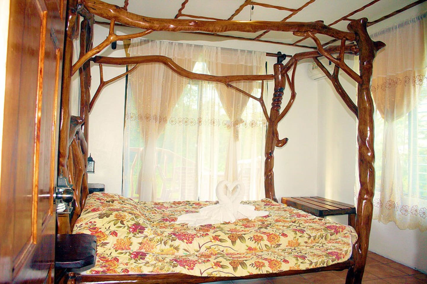Rustic Handmade Queen bed in the Colibri Casita (Hummingbird) master bedroom
