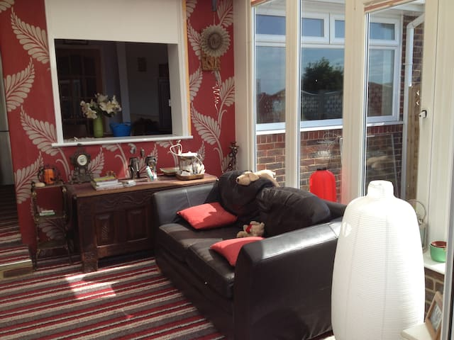 Heated full glass conservatory, offering views of the rear garden. In bad weather, smoking is allowed in conservatory.