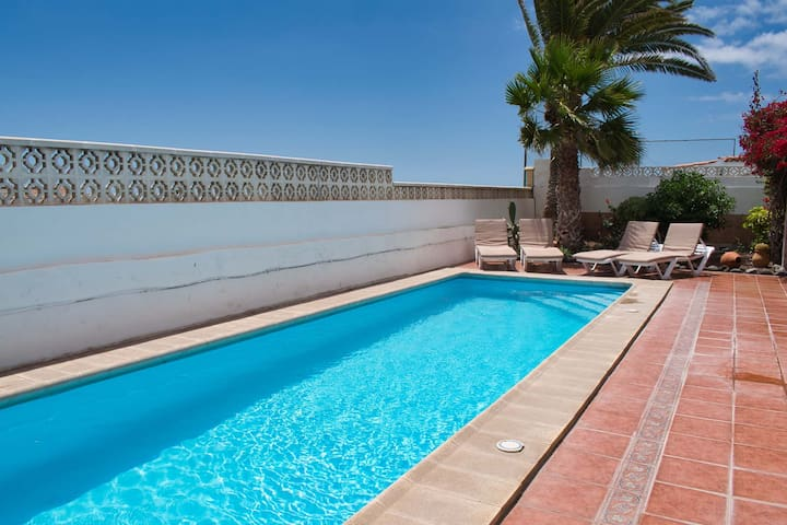 The lovely large swimming pool