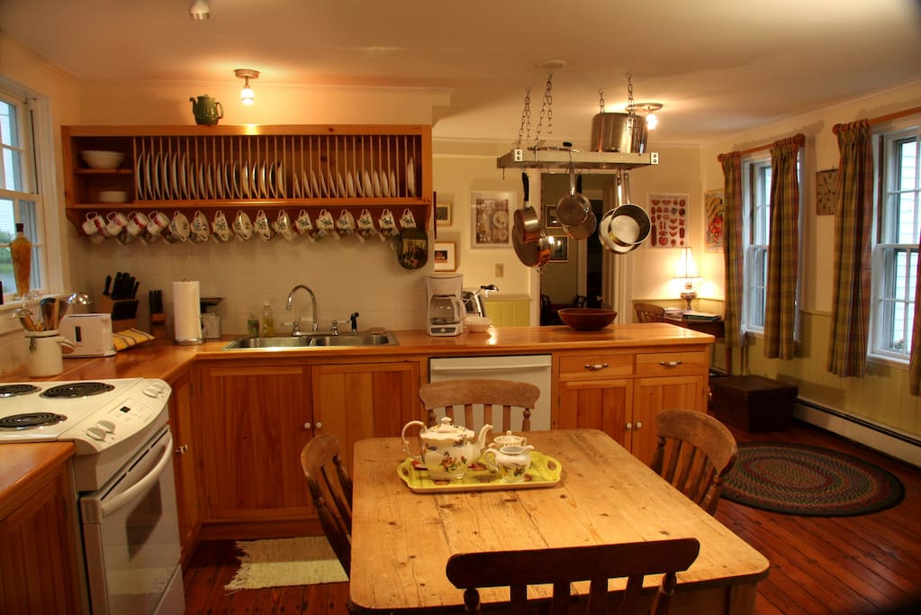 The lovely old eat-in kitchen, with hand-crafted units.  English victorian pine table and chairs.