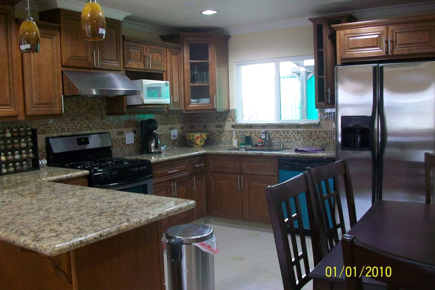 Fully remodeled kitchen with granite countertop and stainless steel appliances.