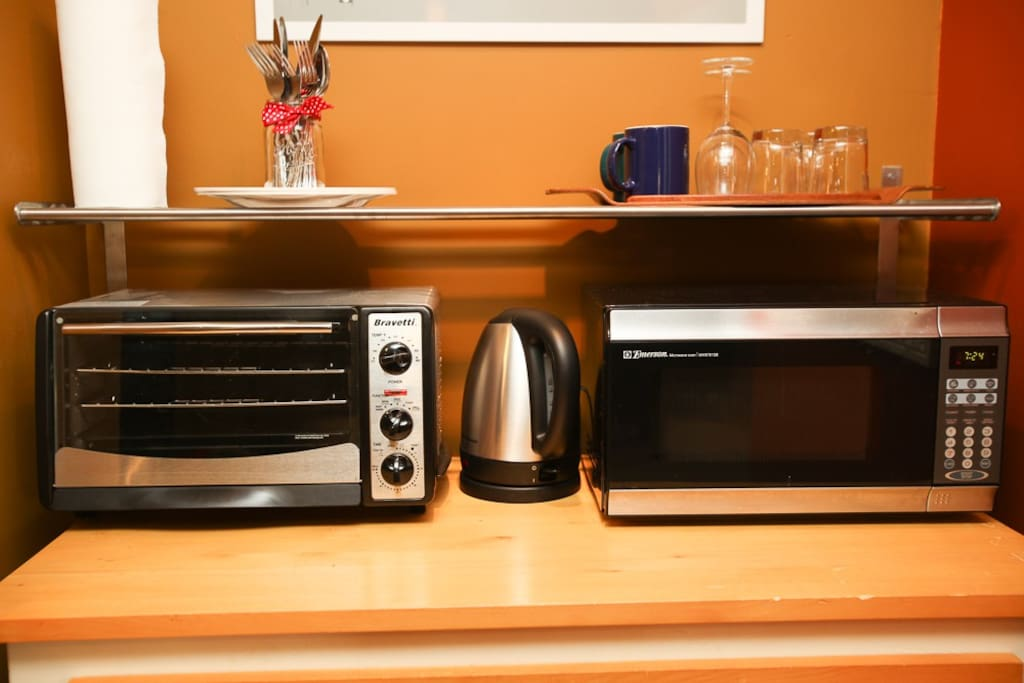 Kitchenette comes with toaster oven, microwave, tea kettle, and more!