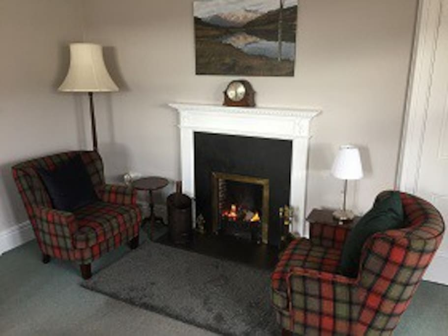 Sitting room with original open fire place for those colder evenings to have a dram of whisky by.