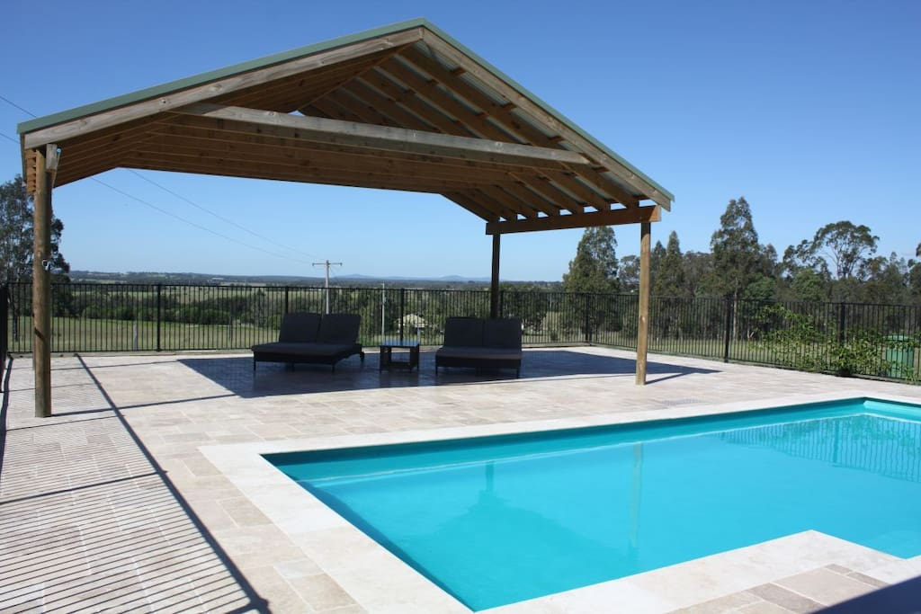 Relax in the swimming pool under the pergola on the day beds.