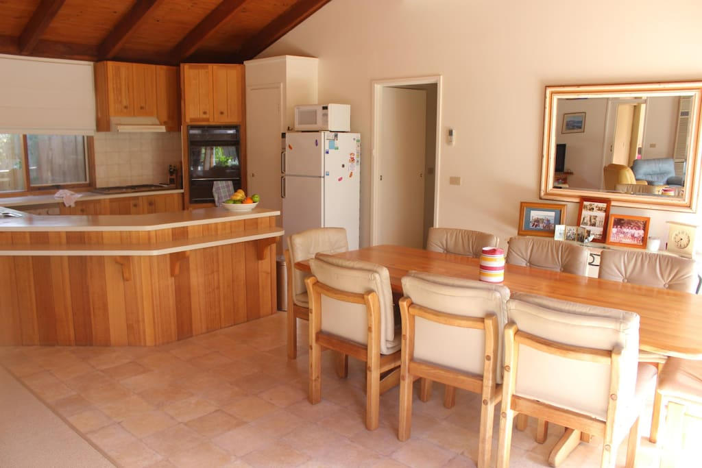 Kitchen with gas cook top, electric oven and dishwasher.