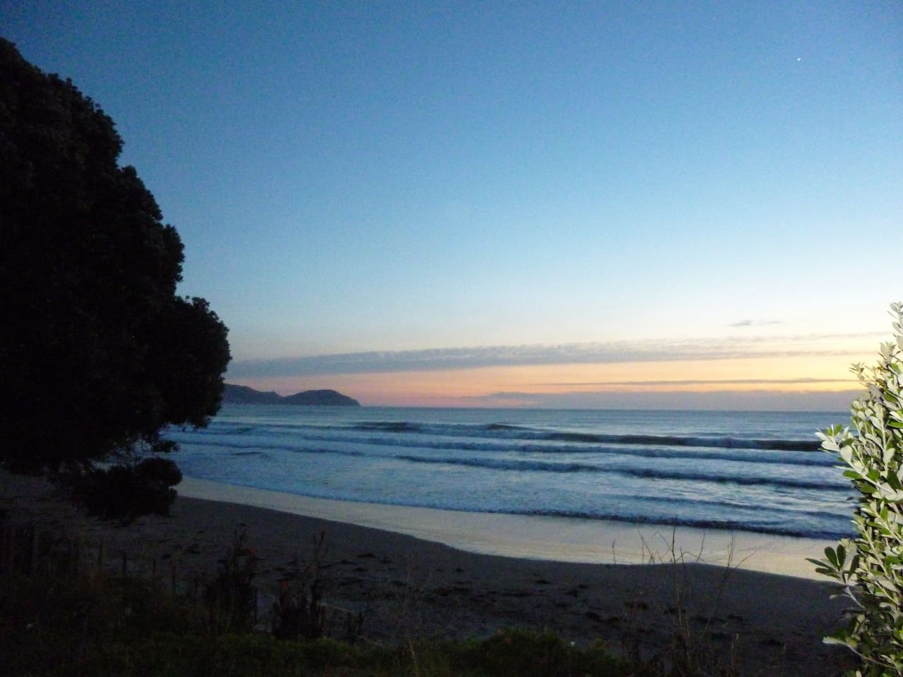 Less than a 2 minute walk to see the sunrise at Wainui.  It is one of the major surf beaches in  NZ.