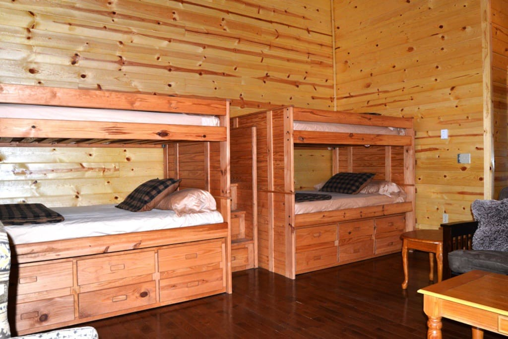 Two sets of bunk beds with four full beds and two twin trundle beds.