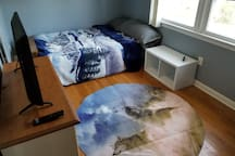 AirBnB Guest Br: Wolfpack Theme  Includes: Queen bed Smart TV Area Rug Nightstand Clock/Alarm clock Dresser/Cabinet Closet