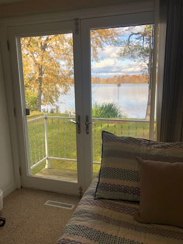 Main bedroom overlooking fall colors on the lake.