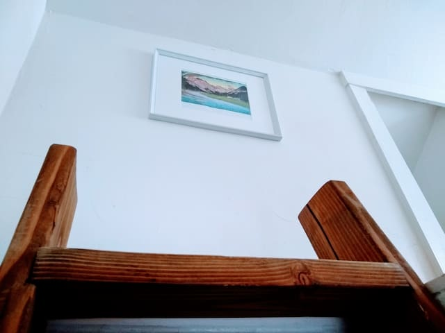 Ladder lead to loft bedroom.