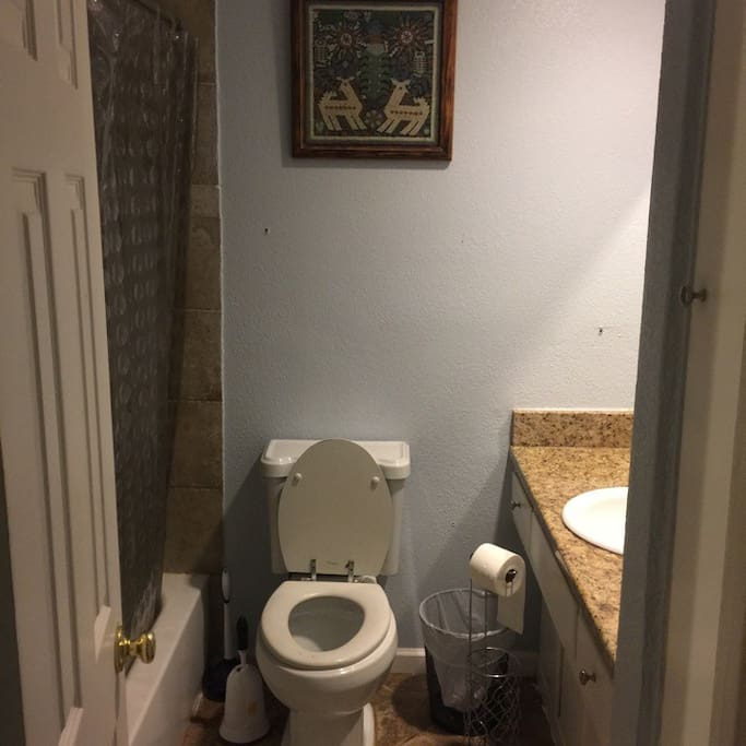 hallway bathroom with full tub