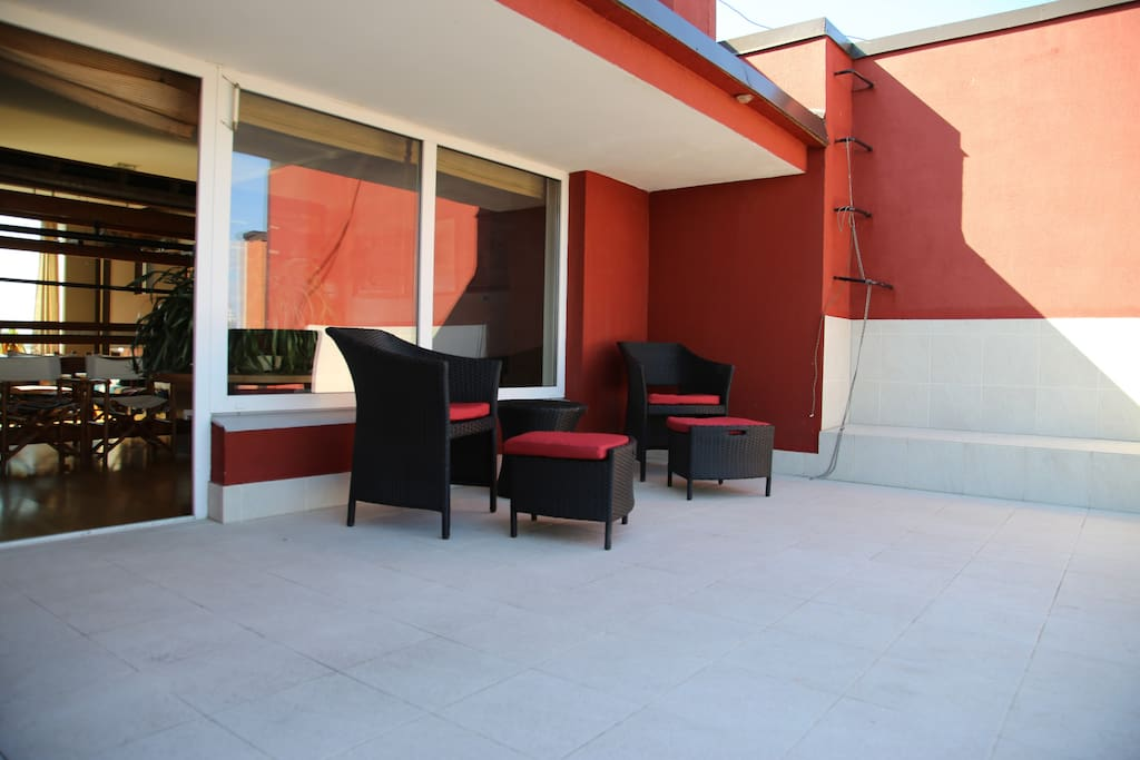 open air terrace with a small shade away and recliners