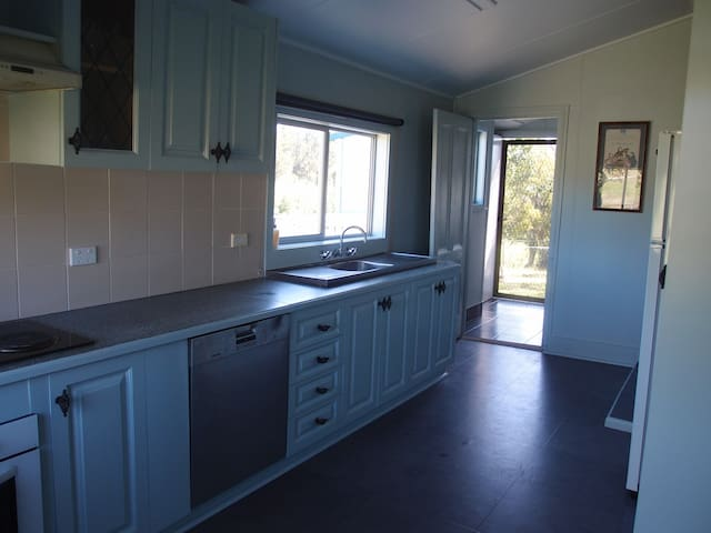 Kitchen - with miele dishwasher and oven,  separate cooktop,  and microwave