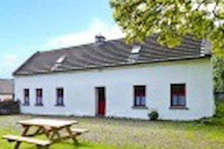 Traditional Irish cottage on farm  - Caher