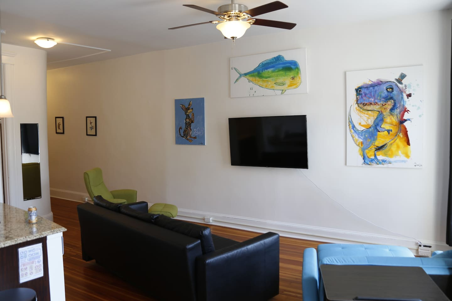 Goodloe Byron's colorful animal artwork graces the walls of his former home :D