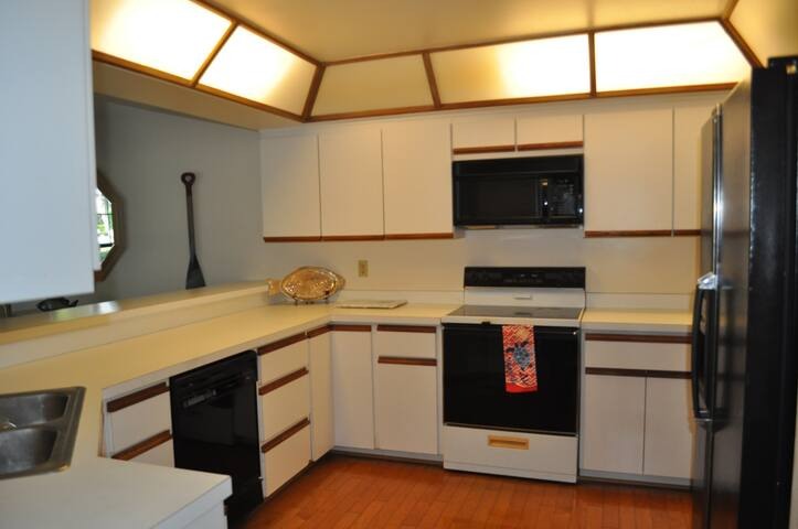 Kitchen has icemaker in refrigerator, dishwasher and microwave.