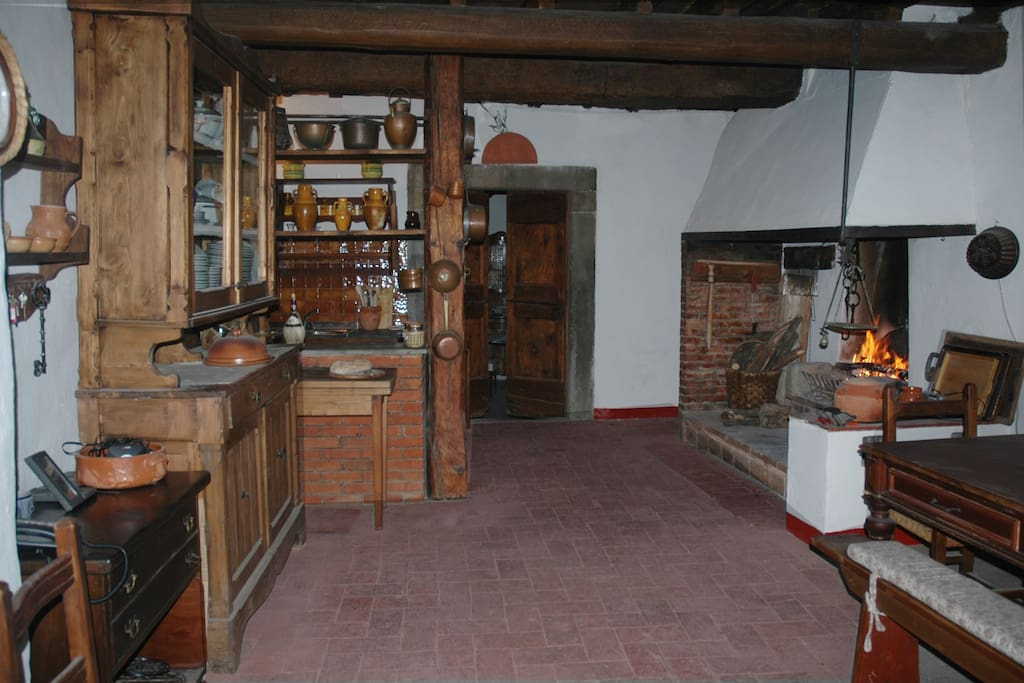 Large eat-in kitchen with traditional fireplace