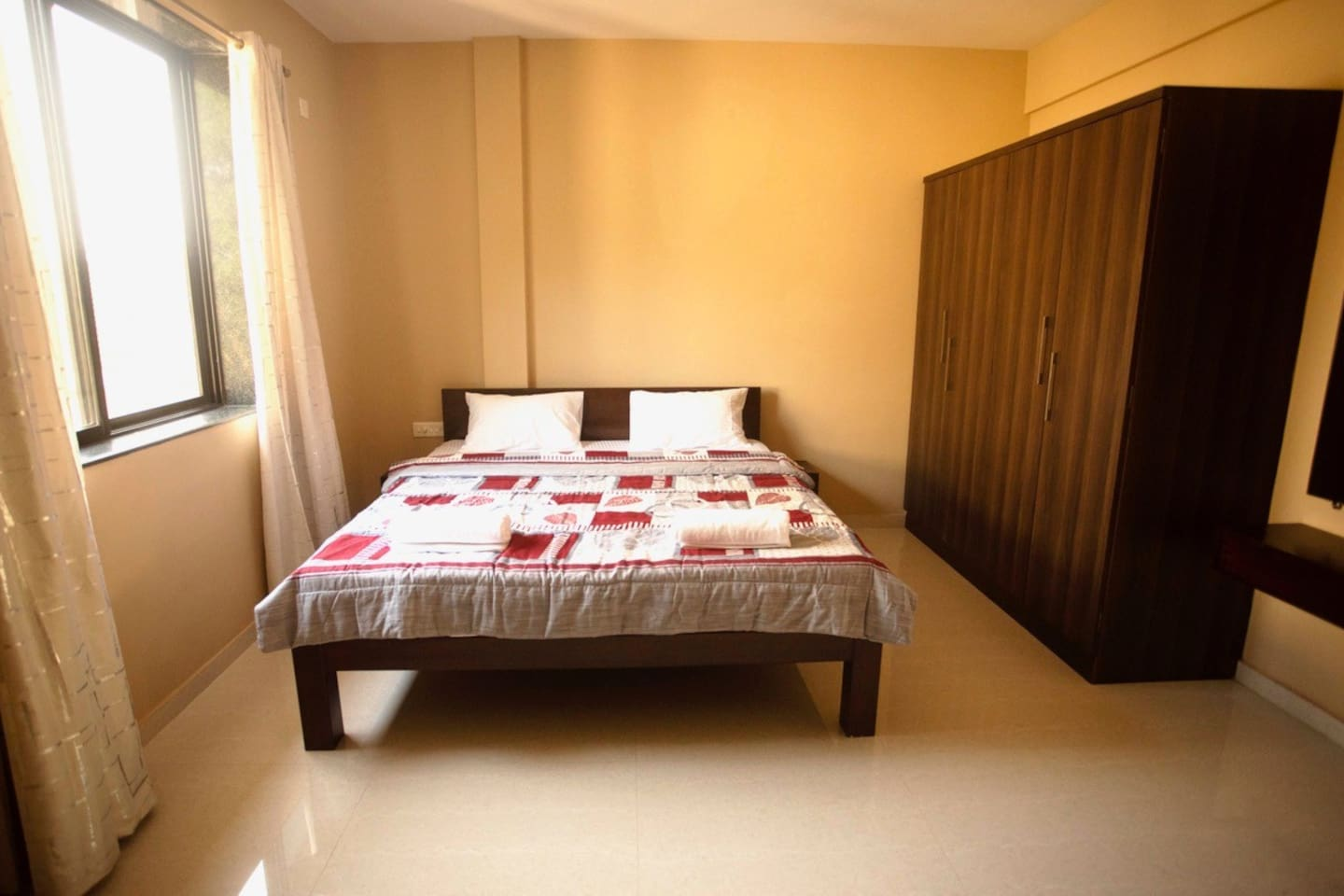Very spacious bedroom and and the cabinet